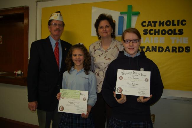 Gail Maholick/TIMES NEWS Winners of the VFW Patriot's Pen Essay Contest were presented awards and checks during an assembly at Ss. Peter and Paul Catholic School. From left are, Harry Wynn IV, past commander; Kennedy Malsch, second place winner;…