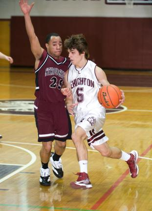 BOB FORD/TIMES NEWS Lehighton's Anthony Rossino (5) dribbles around Stroudsburg's Cliff Bragg on his way to the hoop. Rossino's reverse layup in the waning seconds lifted the Indians to an upset win over the Mountaineers.
