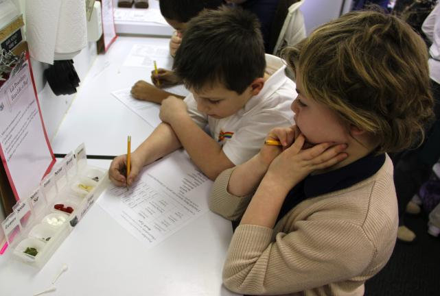 ANDREW LEIBENGUTH/TIMES NEWS 2nd graders Bryce Bieber, 7, and Jessica Stackhouse, 7, work together to figure out what level of damage various environments can have on agriculture.