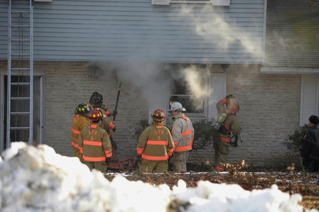 BOB FORD/TIMES NEWS Firefighters battle a blaze at a dwelling along Birchwood Drive in the Mahoning Heights section of Mahoning Township, Thursday afternoon. Significant damage was reported to the garage area and lower level of the dwelling. The…