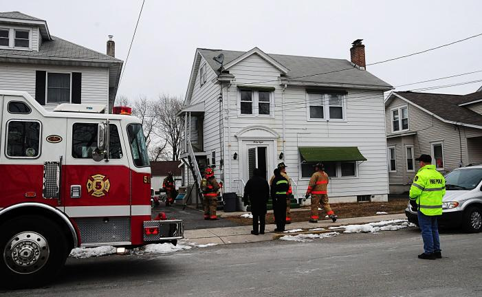 Larry Neff/SPECIAL TO THE TIMES NEWS Firefighters respond to 38 Lentz Avenue, Lehighton, when an electrical box in the basement of the home began burning. First on the scene were employees of the Lehighton Light and Power Department, who cut the…