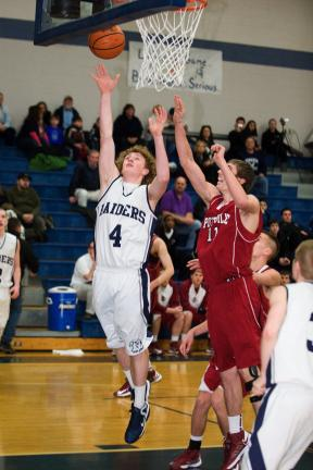 Bob Ford/TIMES NEWS Tamaqua's Tyler Krell puts up a shot while Pottsville's Bobby Witman defends.