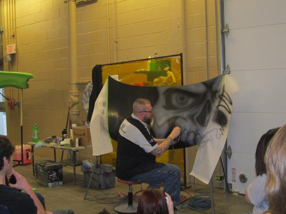 HEATHER BACSICK/SPECIAL TO THE TIMES NEWS Tom Banks, a staff member of the custom paint and graphic arts program at Ohio Technical College, gives students at Carbon Career and Technical Institute an airbrushing demonstration and motivational discussion.