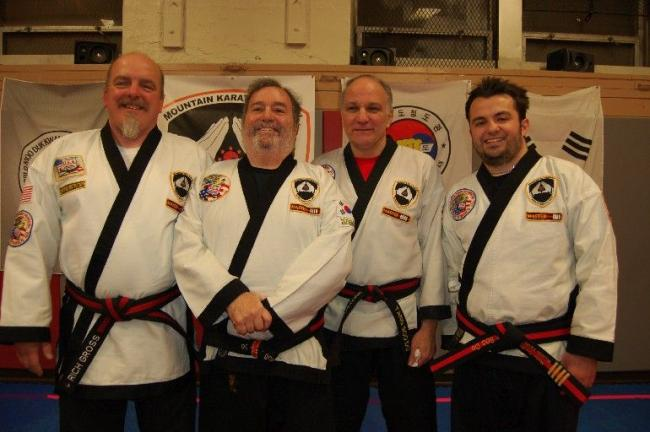 Gail Maholick/TIMES NEWS During a special black belt promotion night at Mountain Karate Academy, Richard Maglionico attained the rank of Master. From left are, Master Rich Gross, Master Richard Maglionico, Master John Fagliarone, and Master Paul…