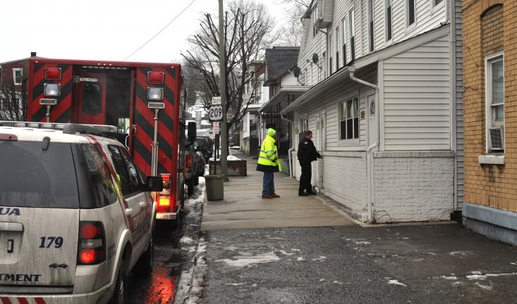 DONALD R. SERFASS/TIMES NEWS Bob Schlorf, left, Tamaqua fire police, and Tamaqua Police Office Mike Hobbs check homes along the 300 block of West Broad Street early Tuesday after reports of gas vapors in the neighborhood and inside homes.
