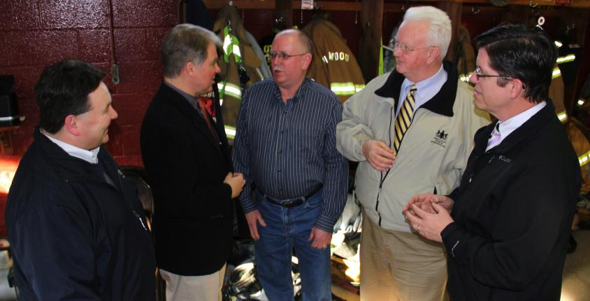 ANDREW LEIBENGUTH/TIMES NEWS Talking with Dave Wertman, center, newly installed President of the SCVFA and firefighter with the American Hose Company in Tamaqua, are, from left, Schuylkill County Commissioner Gary Hess, Senator Argall,…
