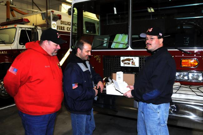 RON GOWER/TIMES NEWS Discussing the 2013 fund raising campaign of the Diligence Fire Company, Summit Hill, are, from left, Ed Nunemacher, president; Len Ogozalek, assistant chief, and Shawn Hoben, fire chief. Last year, only about 40 percent of the…