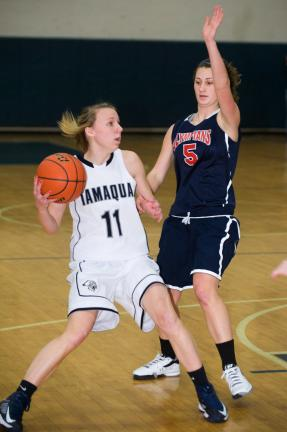 bob ford/times news Kori Kabilko (11) of Tamaqua looks for an open teammate as Jim Thorpe's Cat Condly defends.