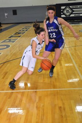 Mike feifel/Times news Northern Lehigh's Annie Tarafass looks to drive baseline on Palmerton's Emelie Meinhart. Palmerton was able to come away with the victory, handling the Bulldogs 54-26.