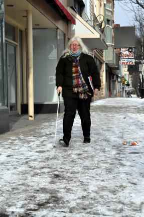 The Rev. Mindy Heppe navigates the sidewalks of Shenandoah aided by her white cane.