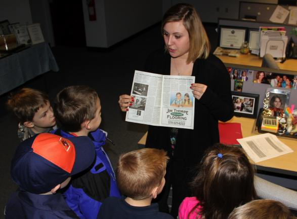 ANDREW LEIBENGUTH/TIMES NEWS Young Scouts with Clamtown/West Penn Cub Pack 756 were treated to a tour of the TIMES NEWS facility in Lehighton Wednesday evening. In addition to learning about the inner workings of creating and printing a newspaper,…