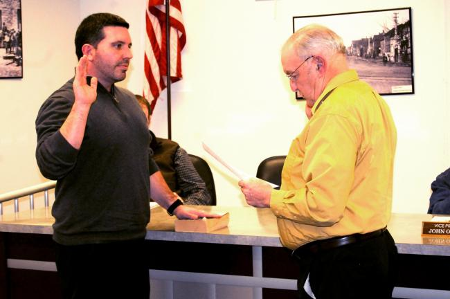 RON GOWER/TIMES NEWS Greg Kosciolek is sworn-in as new member of Summit Hill Borough Council by Mayor Paul McArdle.
