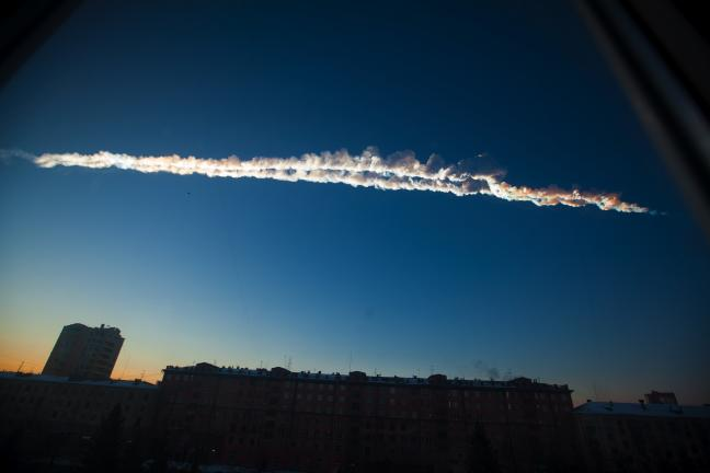 AP PHOTO In this photo provided by Chelyabinsk.ru a meteorite contrail is seen over Chelyabinsk on Friday. A meteor streaked across the sky of Russiaís Ural Mountains on Friday morning, causing sharp explosions and reportedly injuring around 700…