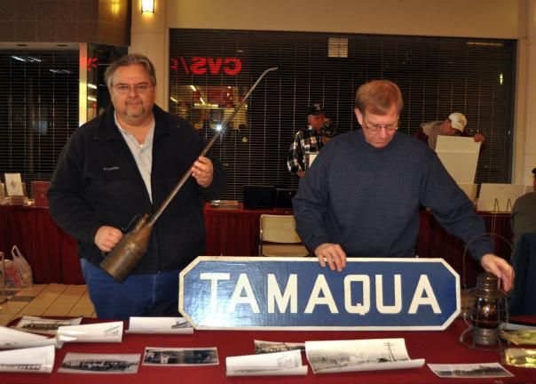 DONALD R. SERFASS/TIMES NEWS Dale Freudenberger, left, Tamaqua, and Bill Harleman, Hometown, set up the Tamaqua Historical Society display at the Schuylkill County History Fair held Saturday at Fairlane Village Mall, Norwegian Township.