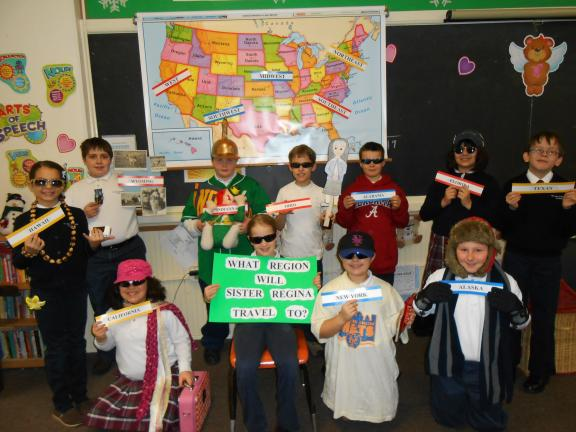 "SPECIAL TO THE TIMES NEWS ""Flat Sister Regina"" recently toured the halls of Our Lady of the Angels Academy. Pictured are the students of Jane Dowling's fourth grade, who taught ""Flat Sister Regina"" about different states. Students are, front row,…"