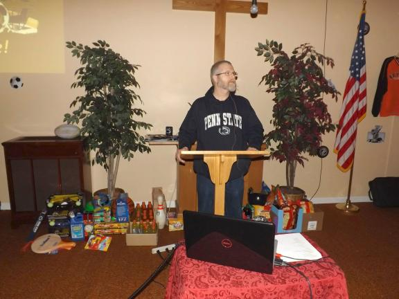 MICHAEL A. HEERY/SPECIAL TO THE TIMES NEWS Pastor Bob Johnson welcomed the approximately 100 men and boys from throughout the area to Salem Bible Fellowship Church in Mahoning Valley recently for the annual Men's Banquet. This year's theme was sports.