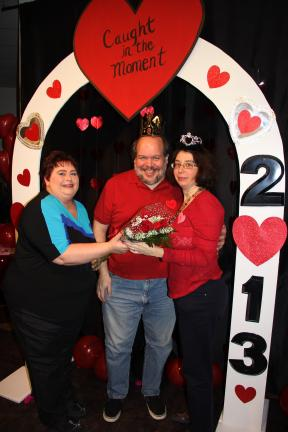 ANDREW LEIBENGUTH/TIMES NEWS Fundraising chair Charlotte Fritz presents the event's King, Dave Snyder, and Queen, Adele Snyder, both of Lansford, with flowers.
