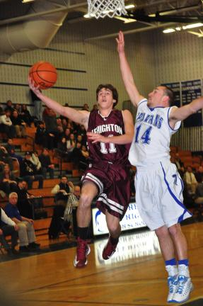 MIKE FEIFEL/TIMES NEWS Lehighton's Tyler Crum floats to the rim as the Spartans' Nick Heiser-Koch tries to defend.