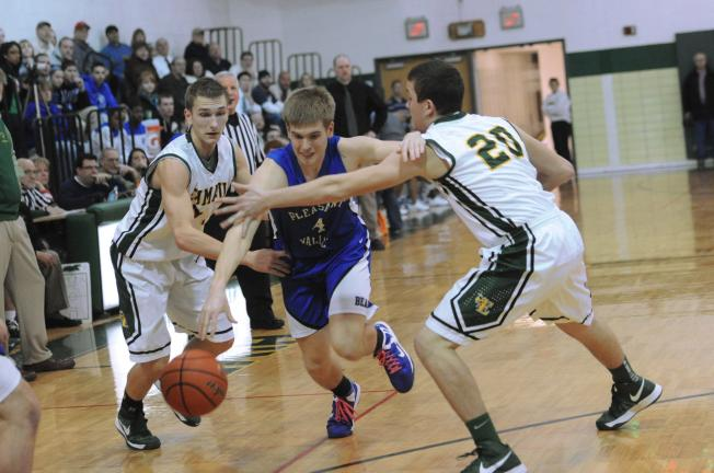nancy scholz/special to the times news Christopher Skutnik of Pleasant Valley (center) tries to split Emmaus defenders Nate Feiertag (left) and Noah Bertram.