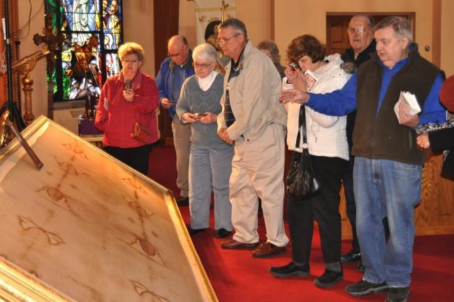 DONALD R. SERFASS/TIMES NEWS Residents of Lake Hauto, Barnesville and Nesquehoning pay a visit Monday to the replica Shroud of Turin exhibit, Shenandoah.