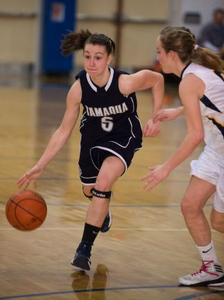 BOB FORD/TIMES NEWS Tamaqua's Paige Demetriades (5) dribbles the card up court with Notre Dame's Lexi McGivern moving in to defend.