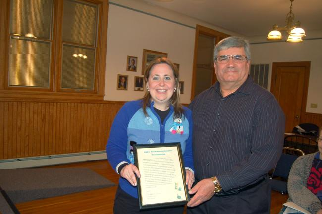 TERRY AHNER/TIMES NEWS Palmerton Borough Councilwoman Holly Sell accepts a proclamation from borough Mayor Chris Olivia, recognizing March 1, 2013, as the National Education Association's Read Across America Day. Sell serves as a Title I Reading…