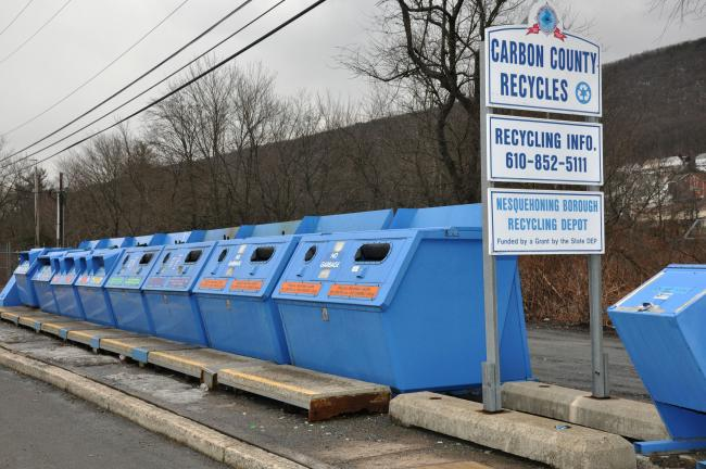 AMY MILLER/TIMES NEWS Carbon County commissioners Thursday voted to end the blue bin recycling program in the county. Over 100 bins, like the bins seen here in Nesquehoning, will be removed, beginning Monday, from 14 sites around the county.