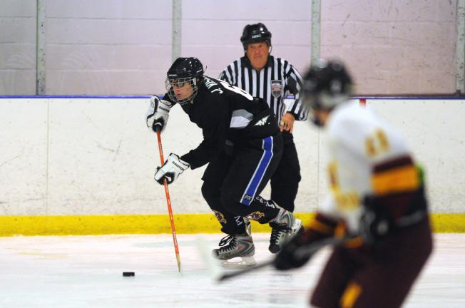 nancy scholz/special to the times news Jon Visconti (left) of the Pleasant Valley/Quakertown hockey team moves up the ice against Whitehall.