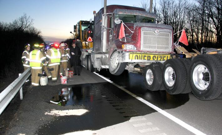 ANDREW LEIBENGUTH/TIMES NEWS Firefighters placed soak barriers to help soak up the diesel fuel after one tractor trailer rear-ended another on Interstate 81 yesterday evening.