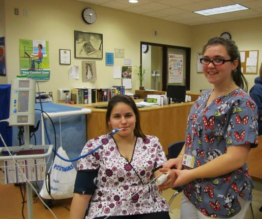 Health/Medical students, L-R, Jessica Biegley, grade 11, and Jeanna Struble, grade 10, give demonstration of how to check blood pressure, temperature, and pulse.