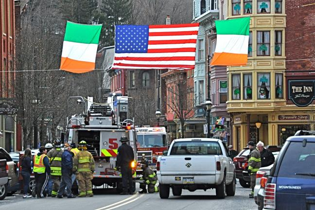 VICTOR IZZO/SPECIAL TO THE TIMES NEWS Raising the colors in Jim Thorpe - In preparation for Sunday's 16th Annual St. Patrick's Day Parade on Broadway in Jim Thorpe, the national flags of both the United States and Ireland have been raised high above…