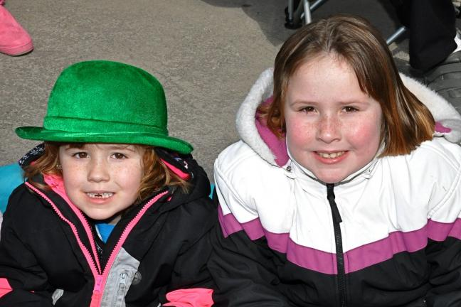 Six-year-old Brooklynne Winger, left, and 7-year-old Fiona Winger, both from Palmerton, were just two of the hundreds of kids anxiously awaiting the start of the 16th Annual Carbon County St. Patrick's Day Parade in Jim Thorpe on Sunday.