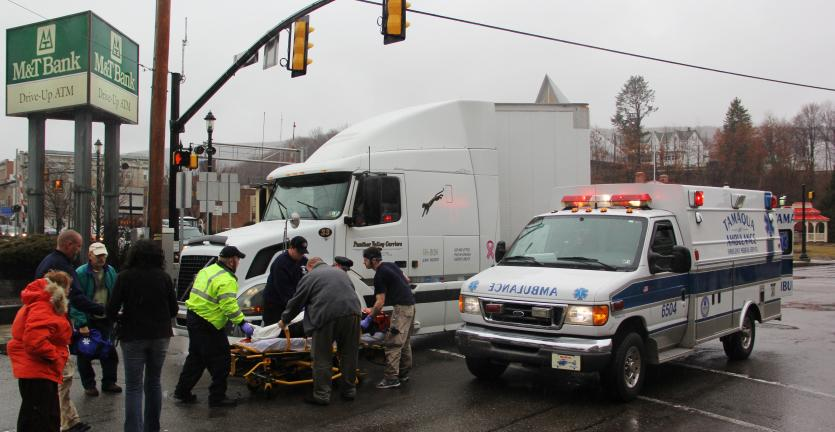 ANDREW LEIBENGUTH/TIMES NEWS Passers-by were quick to aid a Tamaqua woman as she lay bleeding in the road after being struck by a box truck. The pictured tractor trailer was not involved in the incident.