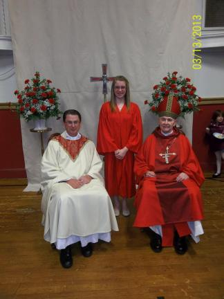 SPECIAL TO THE TIMES NEWS Confirmed yesterday at the Parish of Saint Jerome in Tamaqua is Kaitlyn Staufenberg with Reverend John Frink, administrator of Saint Jerome and His Excellency, Bishop Edward Cullen, retired Bishop of the Diocese of Allentown.