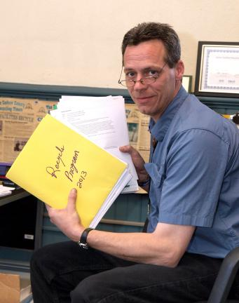 AL ZAGOFSKY/SPECIAL TO THE TIMES NEWS Duane Dellecker, director of the Carbon County Department of Solid Waste and the coordinator of the terminating countywide recycling program, holds folders of reports from meetings related to the decision to end…