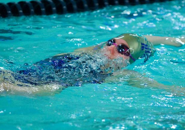 Caroline Kanaskie swims the backstroke during a meet earlier this season.