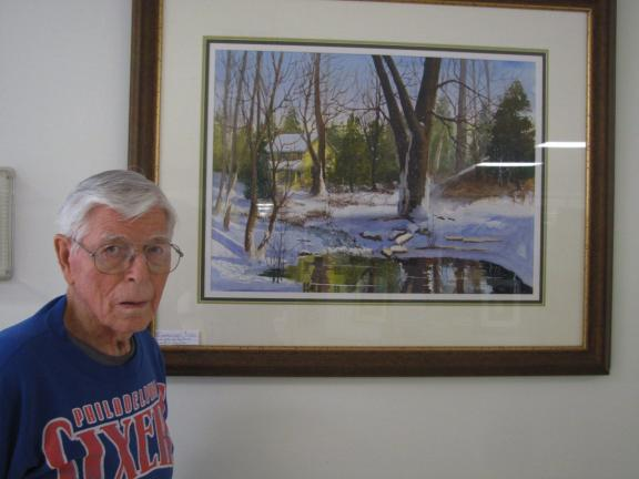 "Bill Wentz, who taught at the Baum School of Art and mentored many members of the art league, stands by his painting ""Winter on the Farm."""
