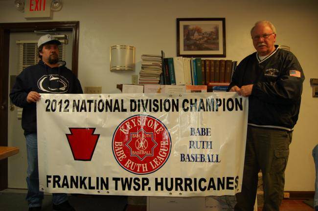 Gail Maholick/TIMES NEWS Ron Steigerwalt, Franklin Township Little League Coach, and Wayne Wentz, president of the Franklin Township Athletic Association, display a vinyl sign that is the same size as those who will be able to display advertising on…