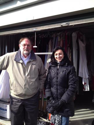 SPECIAL TO THE TIMES NEWS George Taylor and Bethlehem YWCA Amber Mirza at the Y's storage facility in Bath after the local gowns had been unloaded.