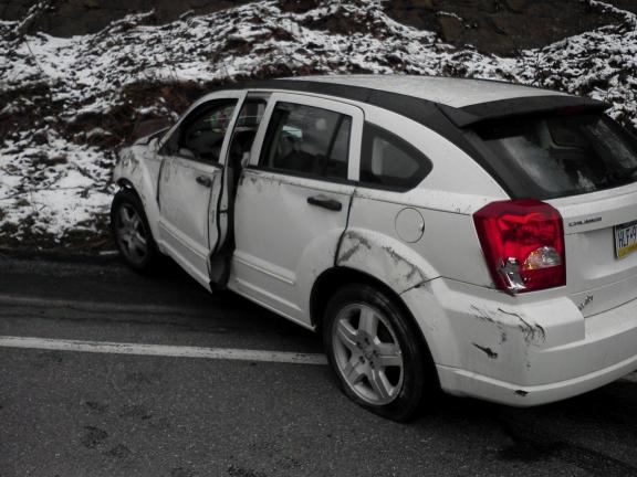 SPECIAL TO THE TIMES NEWS Car operated by Andrea Sargent, 38, of Jim Thorpe, rests against mountain along Route 209 between Jim Thorpe and Mahoning Township on March 17.