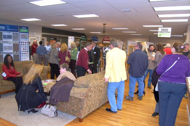 "TERRY AHNER/TIMES NEWS Members of the Carbon County Chamber of Commerce mingle at its ""Business After Hours"" networking event held Thursday at Home Solutions Partners in Palmerton."