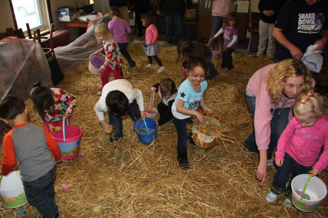 ANDREW LEIBENGUTH/TIMES NEWS Members of the Sons of the American Legion and Auxiliary hosted their annual indoor egg hunt recently. In addition to prizes, the event also included a visit and photos with the Easter Bunny. Children run through hay to…