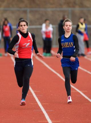 bob ford/times news Jim Thorpe's Anjelica Poalillo runs past Marian's Sadie Kosar for the 100 meter victory.