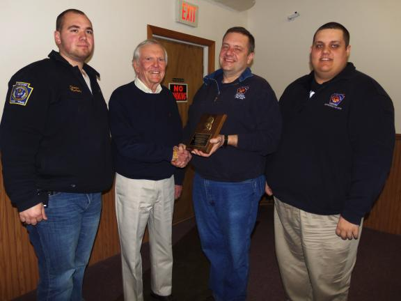 CAROL ZICKLER/SPECIAL TO THE TIMES NEWS Robert Marouchoc, Nesquehoning councilman (second from left) presents a plaque of honor to Nesquehoning Hose Company #1 members for their unending training when they secured their new aerial truck…
