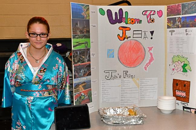 VICTOR IZZO/SPECIAL TO THE TIMES NEWS Dressed in a traditional Kimono, Kyra Popovitz introduced visitors to the country of Japan during Multicultural Night at Penn Kidder Elementary School.