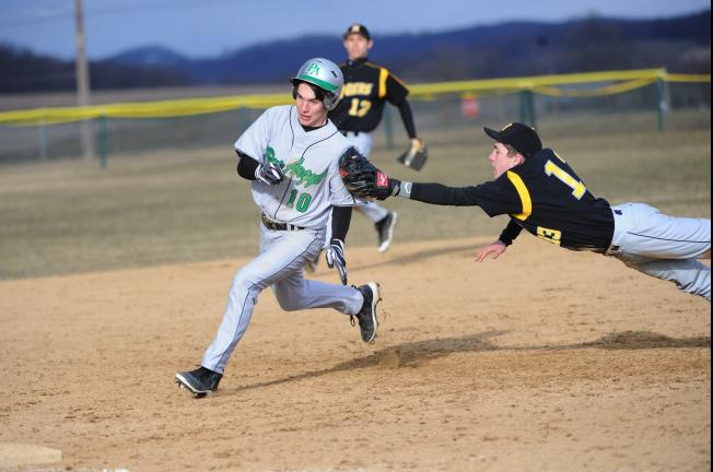 nancy scholz/times news Pen Argyl's Scott Ackerman (10) tries to avoid the diving tag of Northwestern's Josh Williamson at third base.