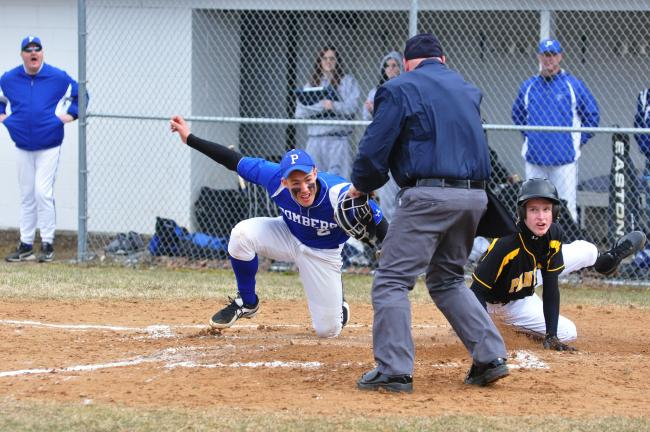 MIKE FEIFEL/TIMES NEWS Palmerton's Lee Kuntz tags out Panther Valley's Jake Szczecina at home to end the first inning. Szczecina tried to score from third on a passed ball.