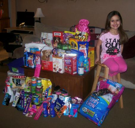 Special to the TIMES NEWS Makayla Sabatino shows off the many dog and cat shelter items she received instead of toys and clothing at her 8th birthday party.
