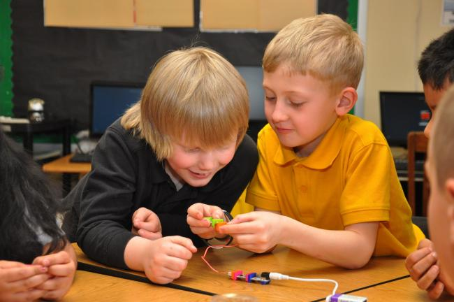 Dylan Richards, left, and Sam Evans, students at Mahanoy Area Elementary, work on building a circuit during a recent SHINE class.