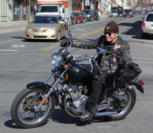 ANDREW LEIBENGUTH/TIMES NEWS Frank Cordeiro, riding a 1982 Yamaha, makes a turn at the Five Points intersection in Tamaqua.
